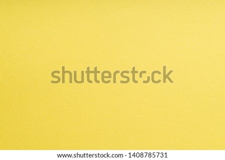 Paper background yellow color. Rough paper texture. Closeup. Macro #1408785731