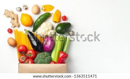 Paper bag of different health food on a table. With copy space.