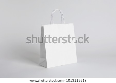 Paper bag on white background. Mockup for design
