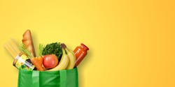 Paper bag vegetables and fruit on a dark background with copy space top view. Bag food concept