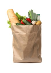 Paper bag with fresh vegetables and bread on white background