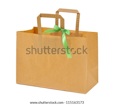 Paper bag  with green ribbon - stock photo