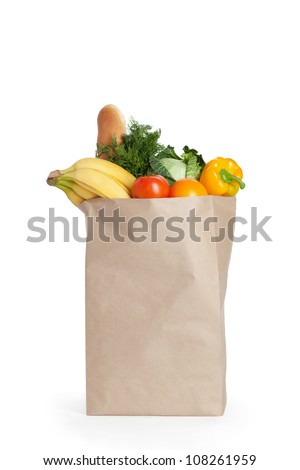 Paper bag with healthy food over white background