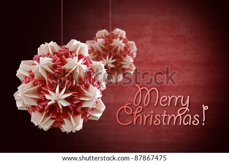 Paper ball for Christmas decoration on red background