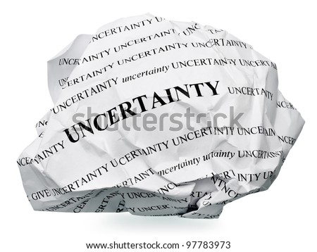 "paper ball with text "" uncertainty "" and clipping path on a white background"