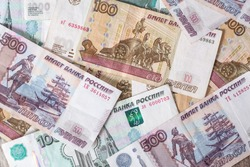 Paper banknotes Russian Rubles. Rubles is the national currency of Russia. bank of Russia The Russian ruble background. A thousand rubles close-up. Fall or rise of the ruble.
