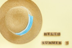 Paper beige background with straw hat and blue medical masks. Conceptual text: