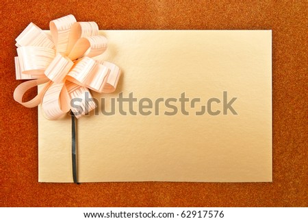 Paper blank with bow on grey background