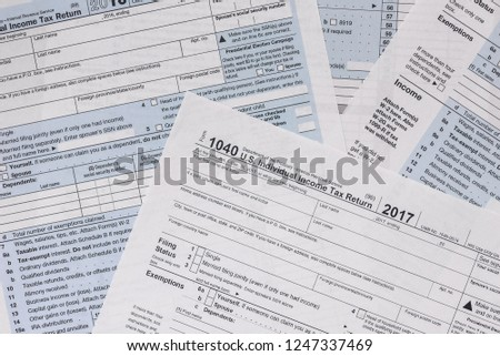 Paper blanks of 1040 tax form close up