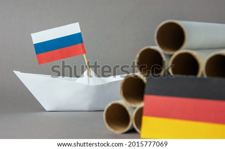 paper boat, gas pipes and the flag of russia, germany and the european union. abstract vision Nord Stream 2 sanctions Project  Photo stock ©