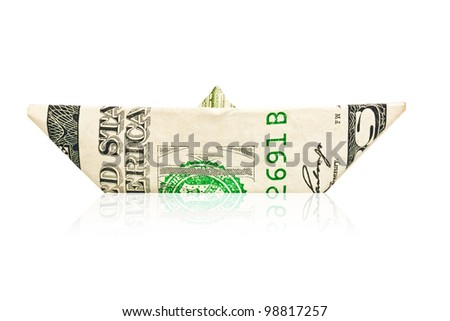 Paper boat made with an american dollar bill with reflections on a white background