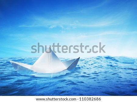 paper boat on a beautiful and vibrant sea