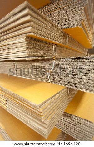 paper box, stack pile of storage of brown paper box in factory