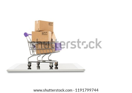 Paper boxes in a trolley with tablet on white background,Online shopping or ecommmerce concept