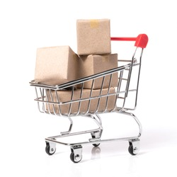 paper boxes parcel in a trolley isolated on red background. shopping online and service home delivery.