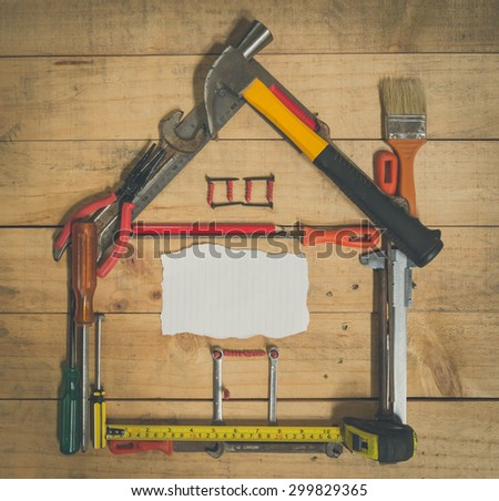 paper card and tool on wood with vintage style