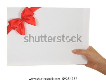 Paper card with red ribbon in woman hand isolated on white background