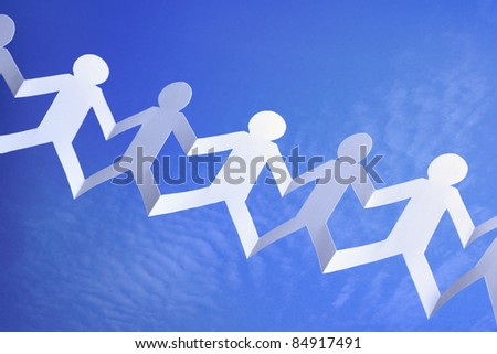 Paper chain community with blue sky background concept for teamwork, networking or social media group