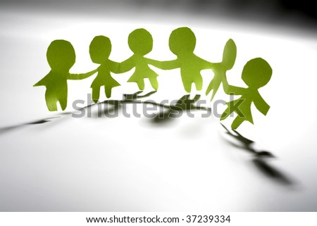 Paper-chain people holding hands - stock photo