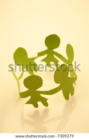 Paper-chain people in a circle holding hands