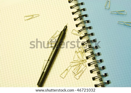 paper ckip and pen on notebook - easy blur for background