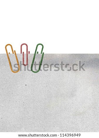 paper clip and paper on white background