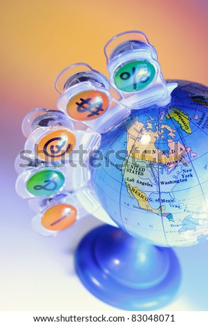 Paper Clips on Globe with Warm Background