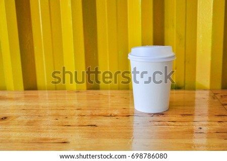 paper Coffee Cup,coffee cup in coffee shop #698786080