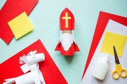 paper craft for kids. DIY toy Saint Nicholas and white horse for sinterklaas day. create art for children. Netherlands Santa Claus