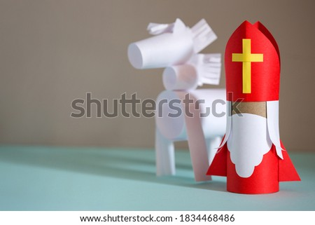 paper craft for kids. DIY toy Saint Nicholas and white horse for sinterklaas day. create art for children. Netherlands Santa Claus Stock photo ©