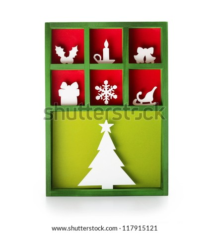 Paper cut Christmas decoration (hand cut) in a wooden display tray.