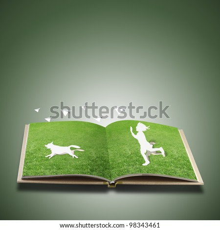 Paper cut of children play on grass book