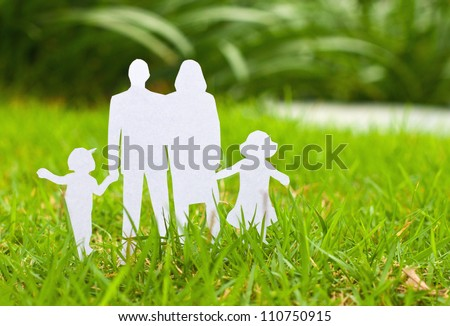 Paper cut of family on fresh spring green grass