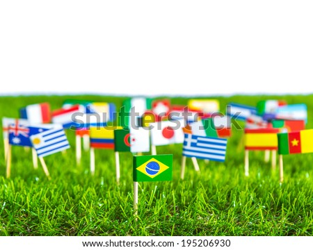 Paper cut of flags on grass for Soccer championship 2014 #195206930