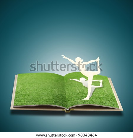 Paper cut of girl doing yoga on old book grass