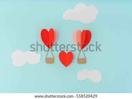 Paper cut of Heart Hot air balloons for Valentine's Day celebration #558520429
