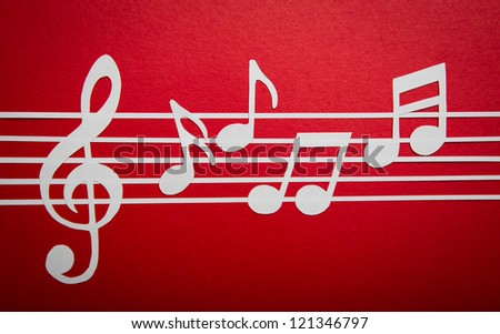 Paper  cut of music note on staves with copy space for text or design - stock photo