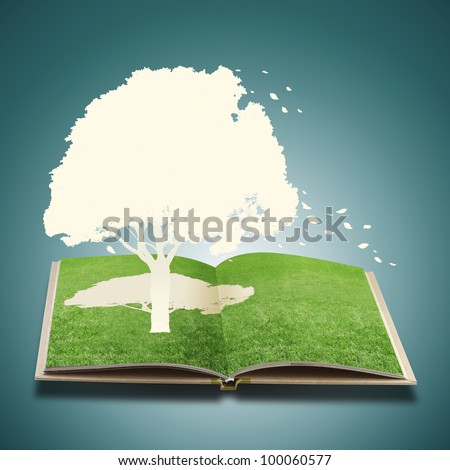 Paper cut of tree on grass book