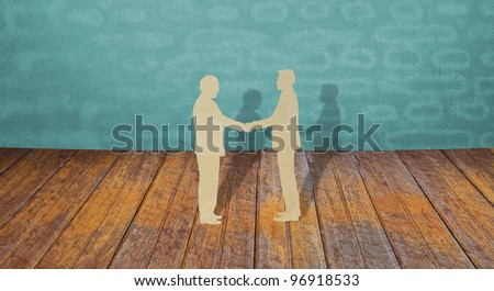 Paper cut of two business man shake hand - stock photo
