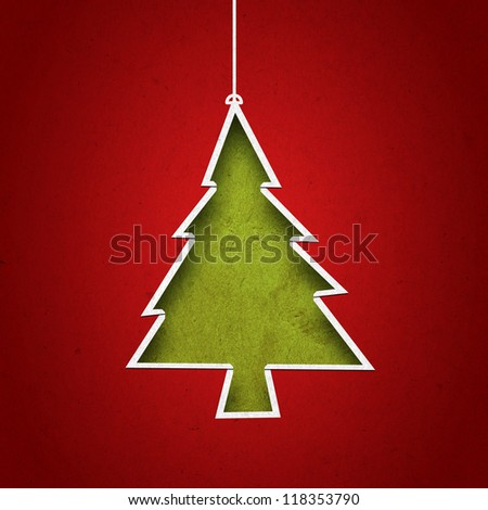 Paper cut to form christmas tree on  green grunge background