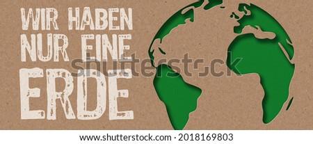 Paper cut - We have only one earth in german- Wir haben nur eine Erde  Stock fotó ©