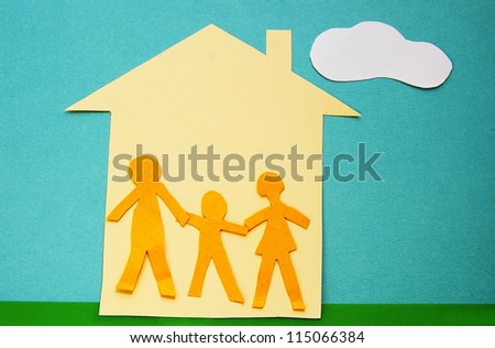paper cutout family in a house with sky and grass