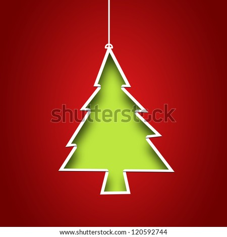 Paper cutout in the middle to form Christmas tree with fresh green background