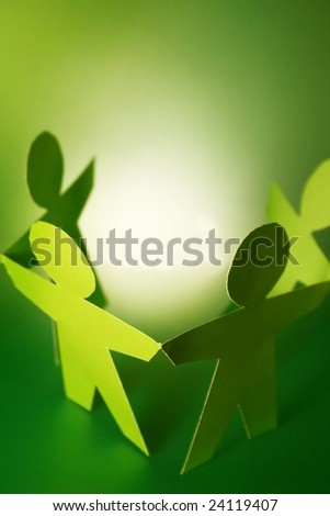 paper cutouts holding hands