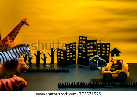 Paper cutting hand mead, Animals and wheel excavator on yellow back ground.  conservation forests and wildlife concept. #773571595