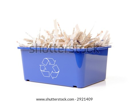 Paper cuttings in blue plastic disposal bin with white recycle symbol - over white background