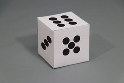 Paper dice on grey background. six points up with five and three. Concept of Speculation or gambling.