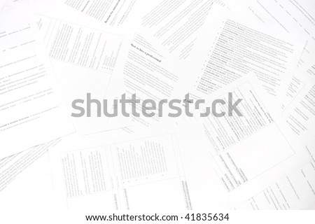 Paper documents scattered with text, information and data. Symbol of bureaucracy