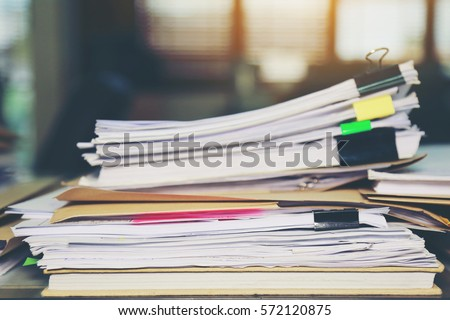 paper documents stacked in...
