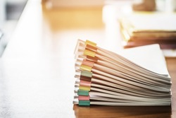 Paper documents stacked on wooden desk at workplace.Business Concept.